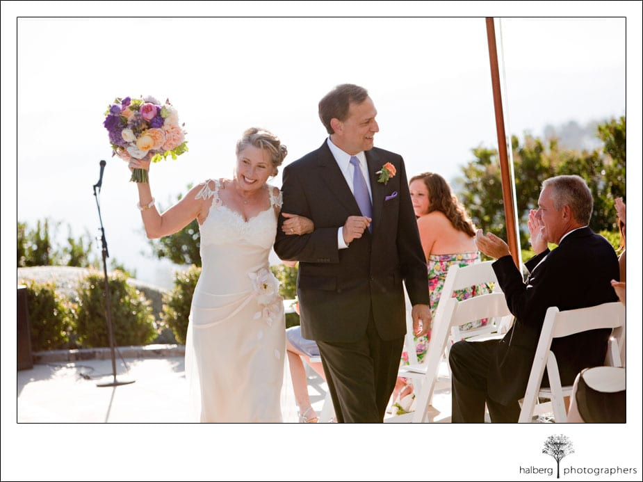 bride and groom walking up isle at their santa barbara wedding