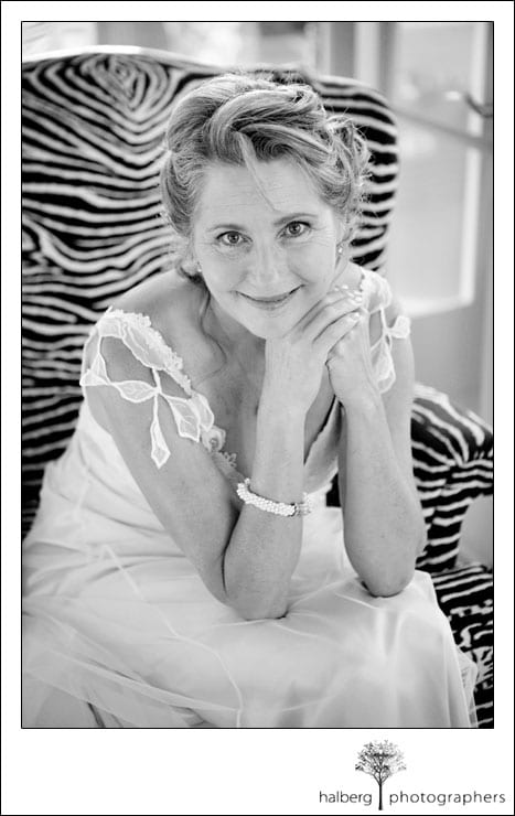 portrait of bride sitting on chair at her santa barbara wedding