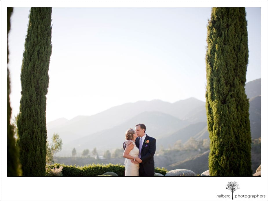 bride and groom kissing with santa barbara hills in background