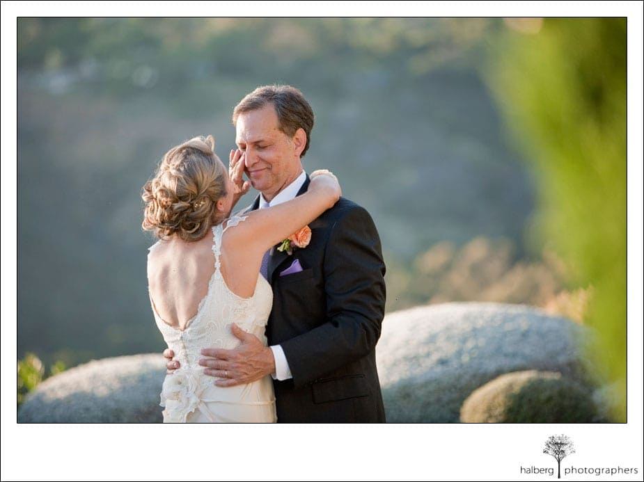 bride wiping tears from grooms eyes at their santa barbara wedding