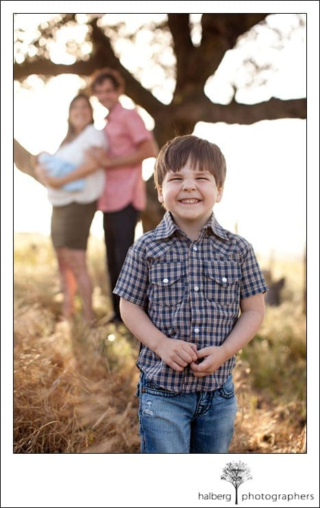 Santa Ynez Portrait of boy smilling with parents in background