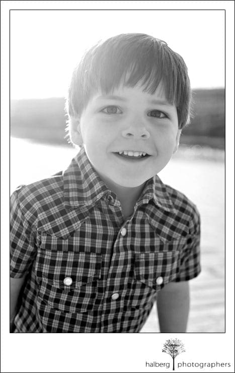 santa ynez portrait of boy smilling in front of lake