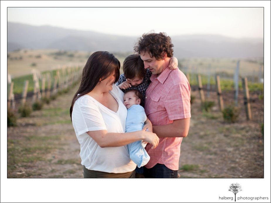 santa ynez family portrait in front of grape vines