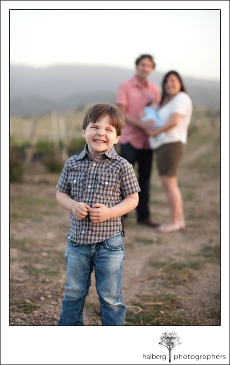 santa ynez family portrait with boy standing in front of parents