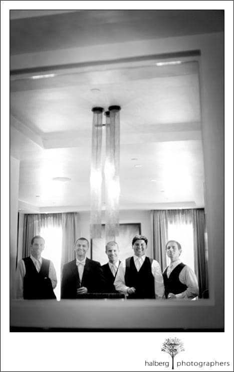 groomsmen reflection in mirror at shoestring winery wedding