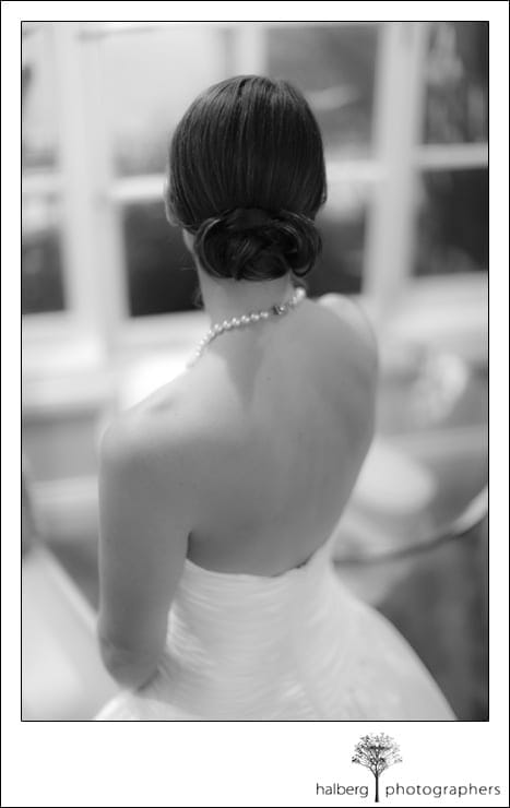 back of bride at her shoestring winery wedding