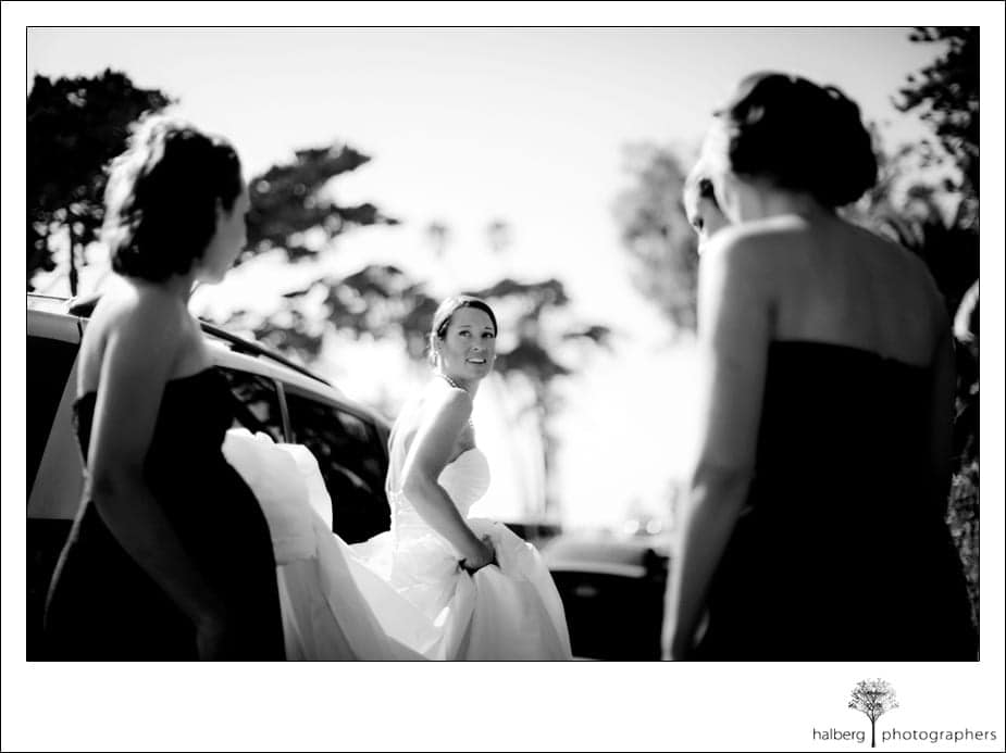 bride walking with bridesmaids before wedding ceremony