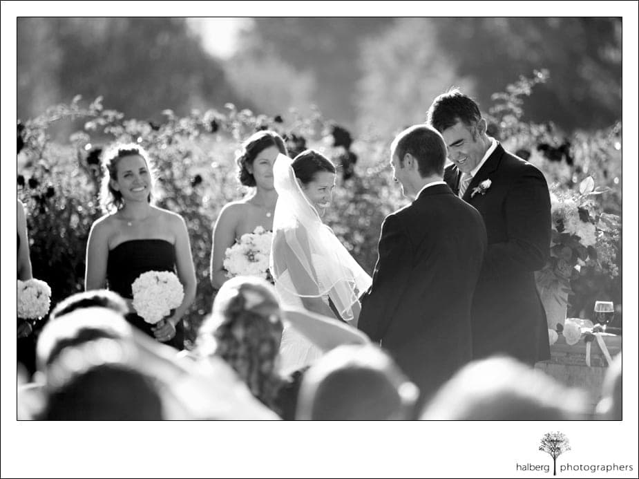 shoestring winery wedding ceremony with bride smiling