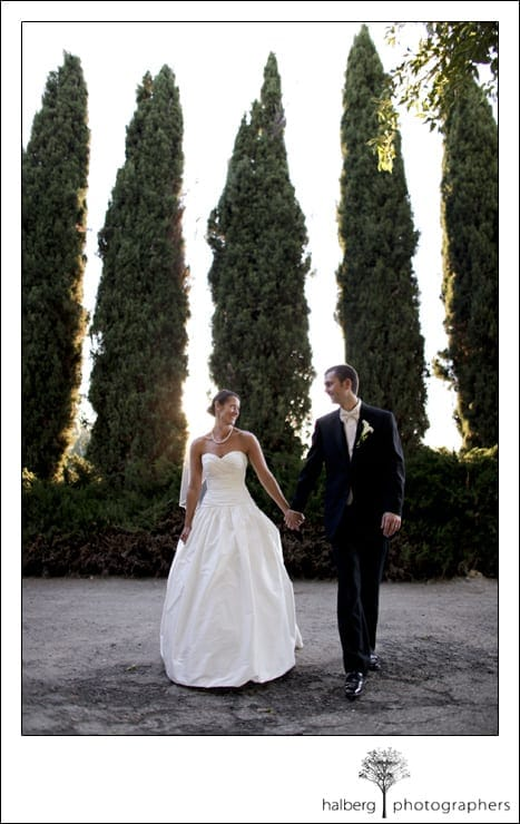 bride and groom walking at shoestring winery