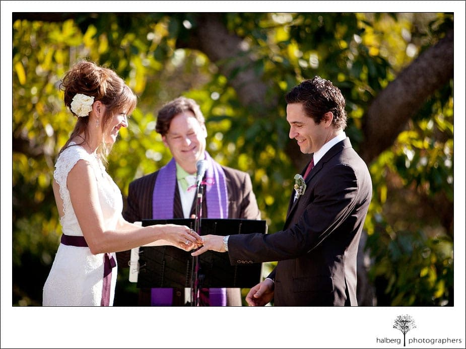 bride and groom exchange rings at montecito wedding