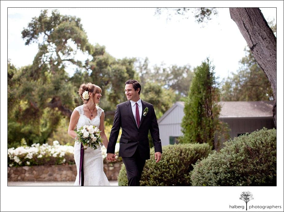bride and groom walking and smiling at their montecito wedding ceremony
