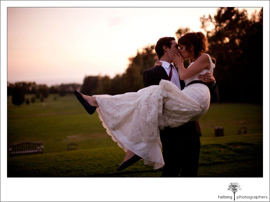 bride and groom kissing at sunset at valley club of montecito