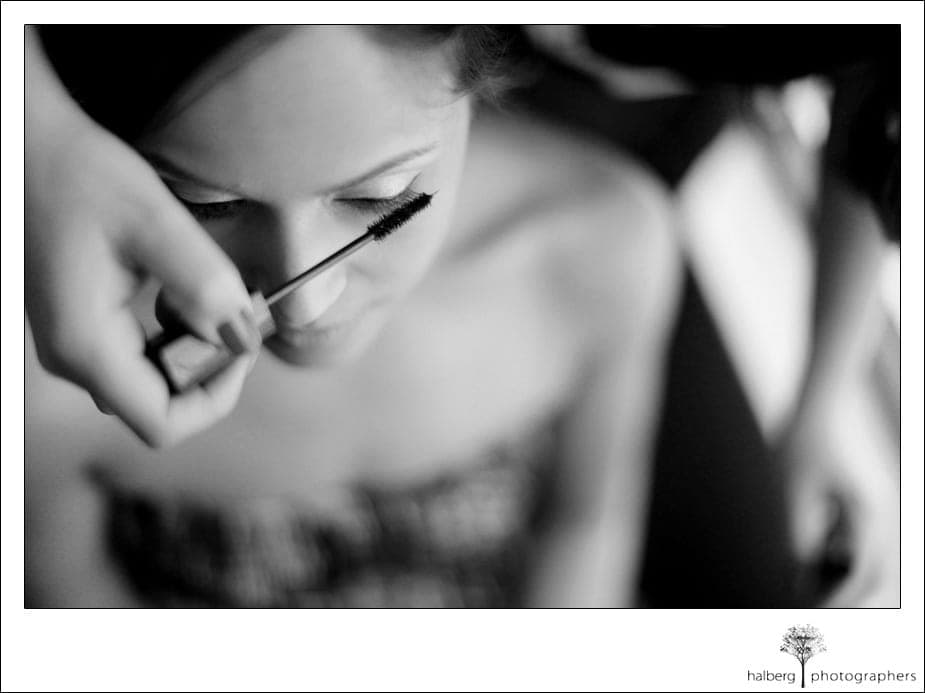 bride's mascara being put on at her destination florida wedding