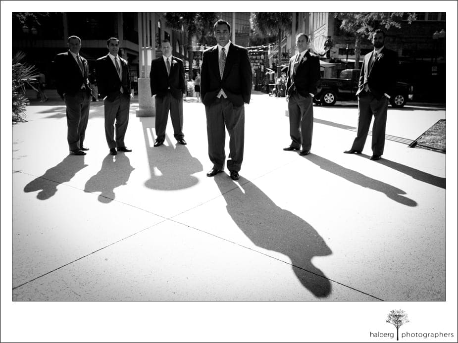 groom standing with groomsmen before his destination florida wedding