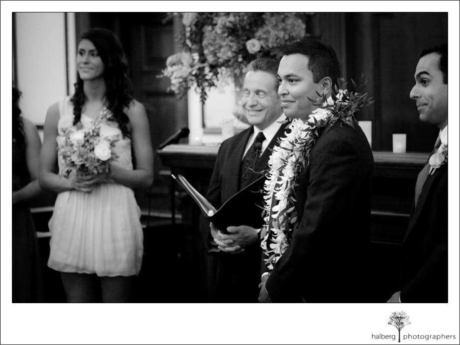 groom watching bride walk down isle at their florida wedding