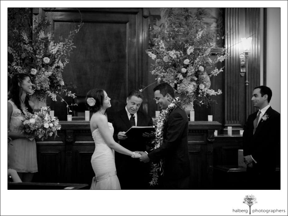 bride and groom laughing at altar for their destination wedding