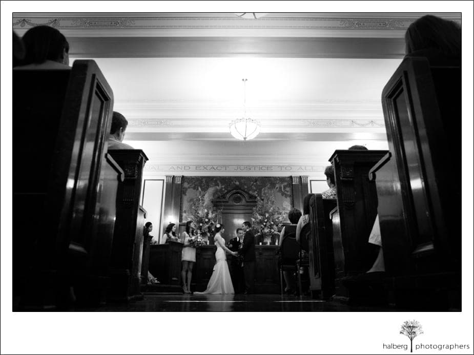 bride and groom holding hands at altar of their destination wedding