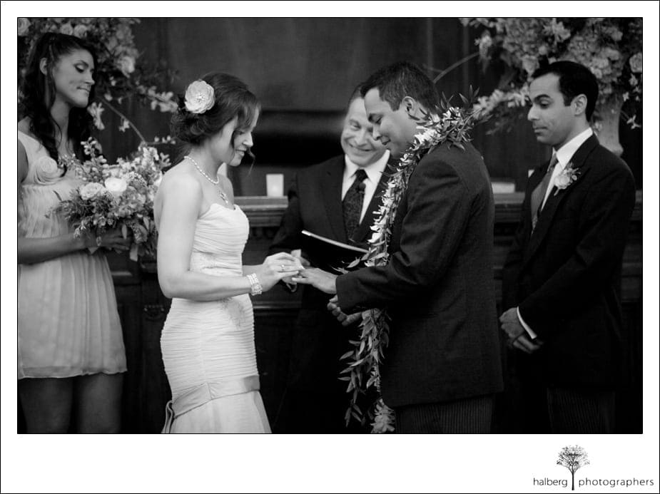 bride and groom exchanging rings at their destination wedding
