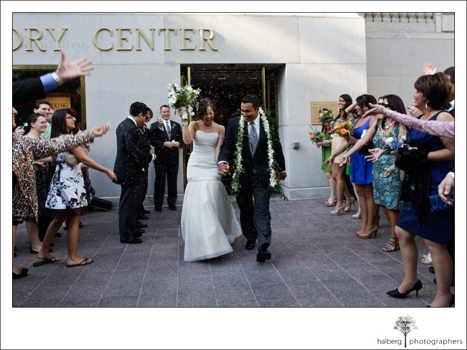 bride and groom exit their destination wedding in florida