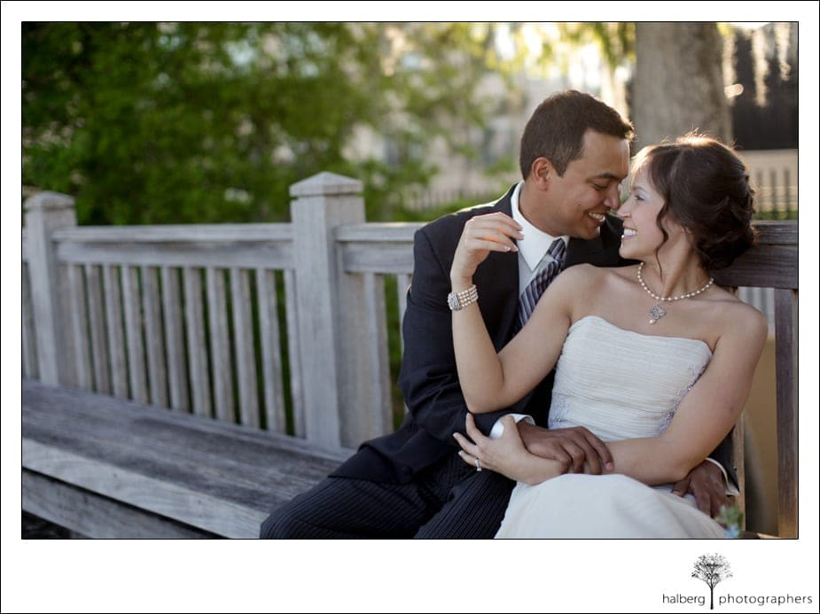 destination wedding bride and groom sitting on bench in florida