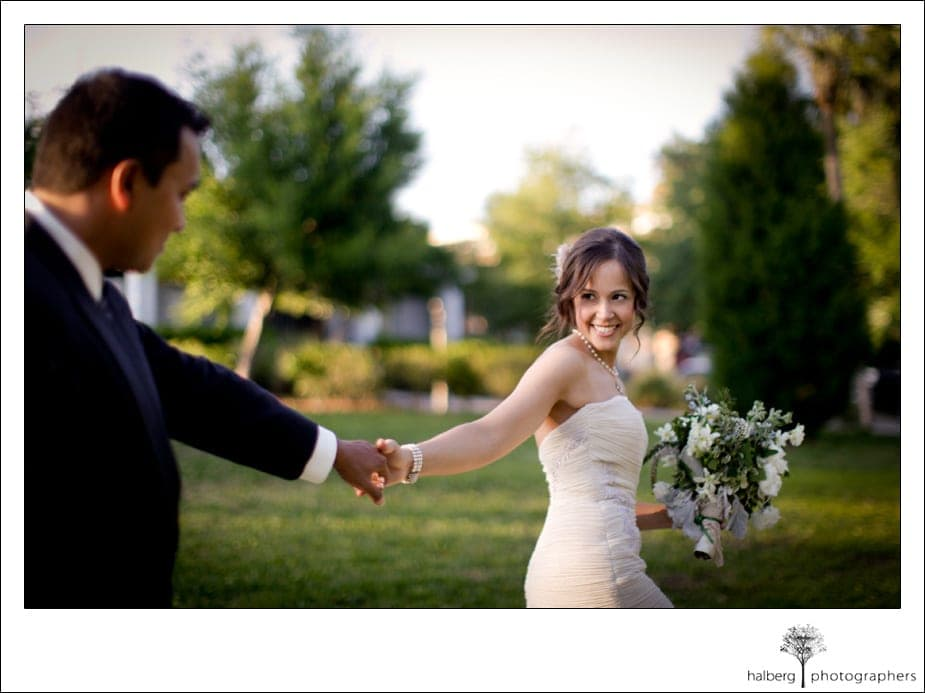 bride pulling groom while walking at their destination wedding in florida