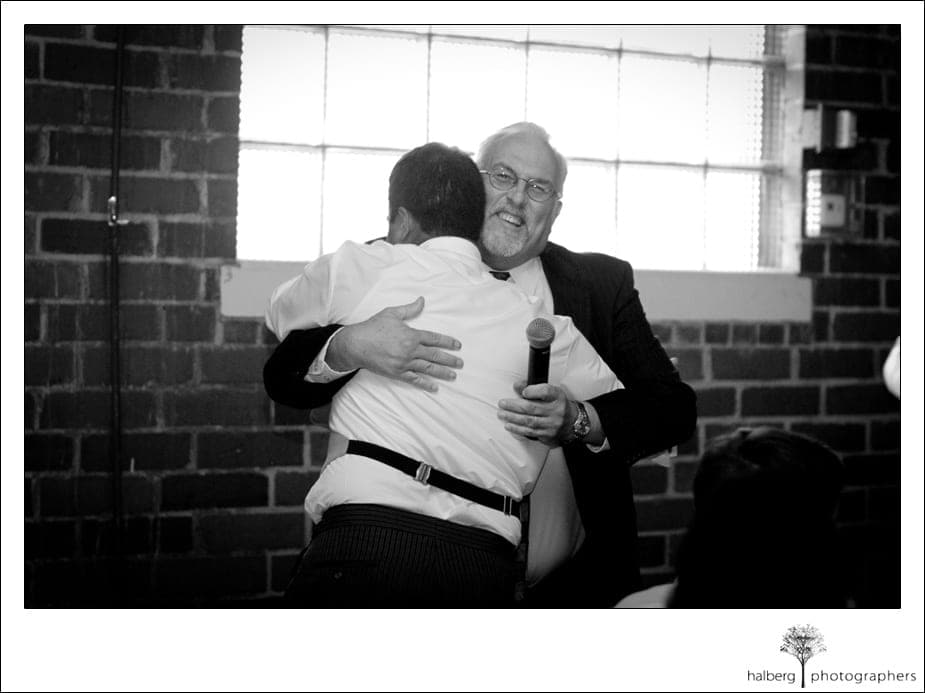groom hugging paul porter at his destination wedding reception