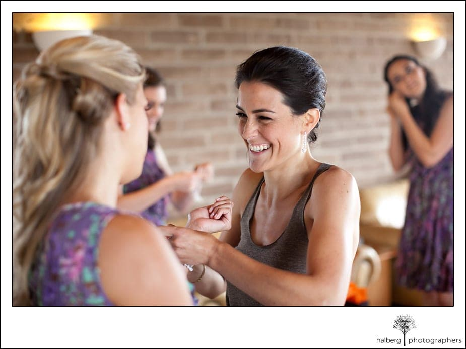 bride laughing with bridesmaid before her heartstone ranch wedding