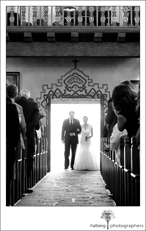 bride with father walking down isle of church