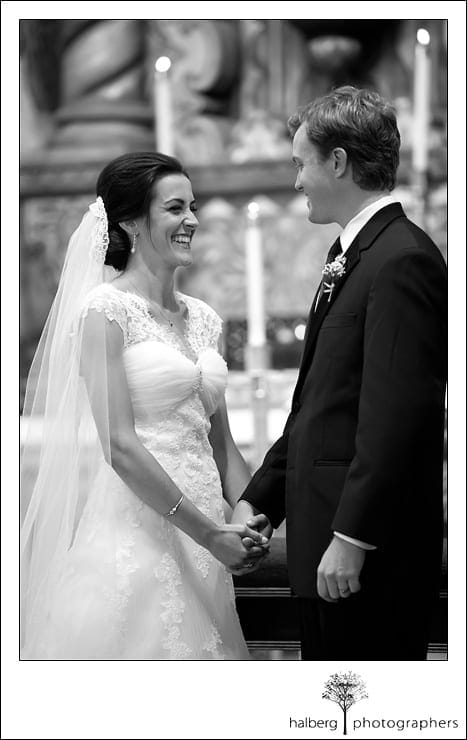 bride and groom holding hands smiling at their wedding ceremony
