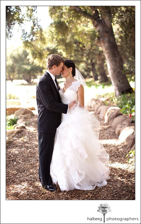 bride and groom kiss on path at their Heartstone Ranch Wedding