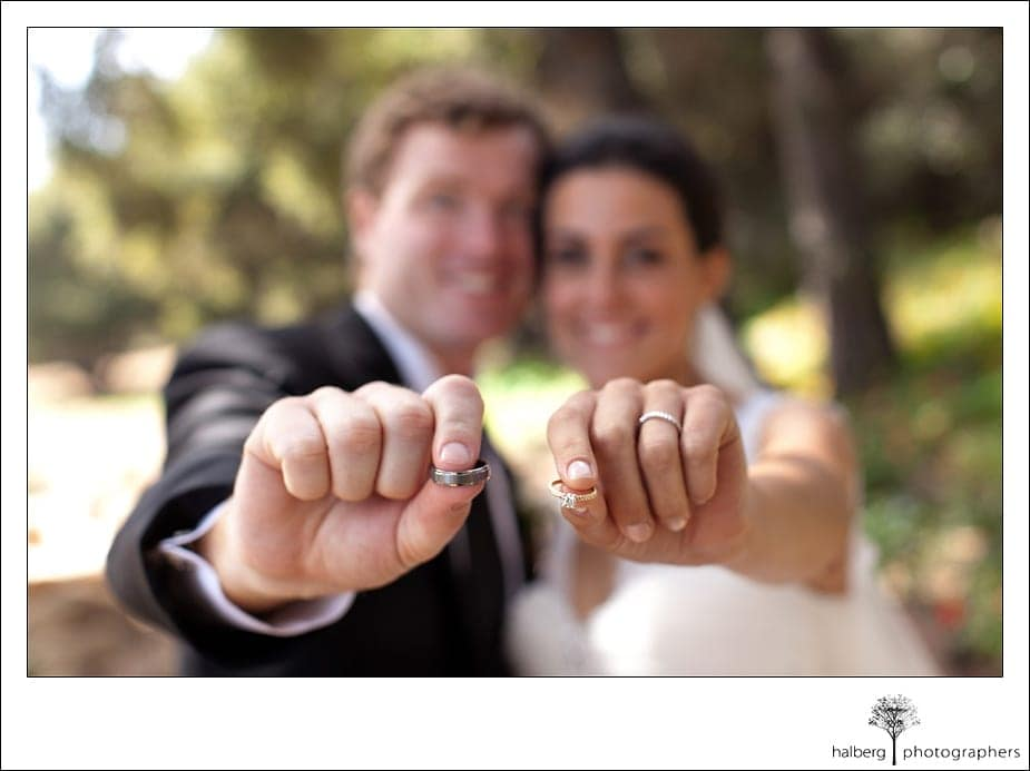 Heartstone Ranch Wedding couple holding rings out in front of them