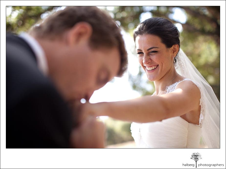 groom kissing brides hand at their Heartstone Ranch Wedding