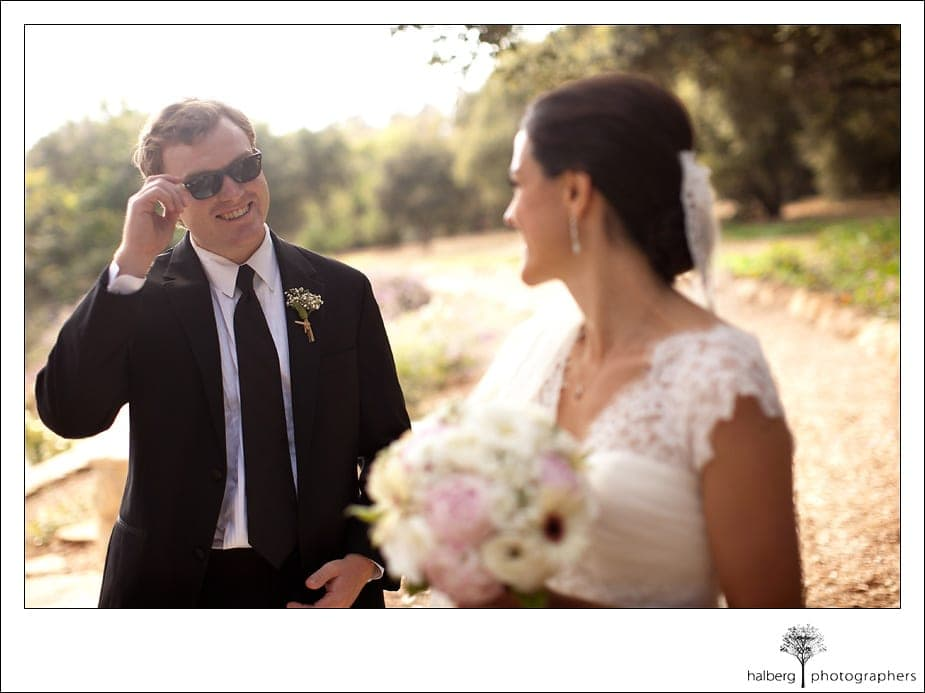 bride looks back at her groom at their Heartstone Ranch Wedding