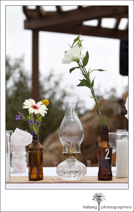 recycled bear bottles hold flowers at a Heartstone Ranch Wedding