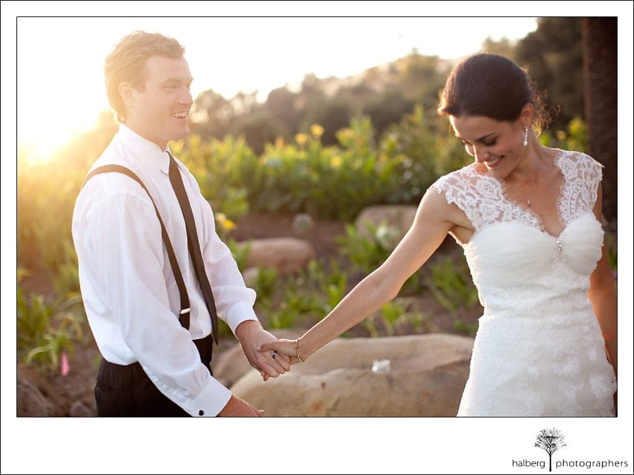 bride leads groom walking through Heartstone Ranch