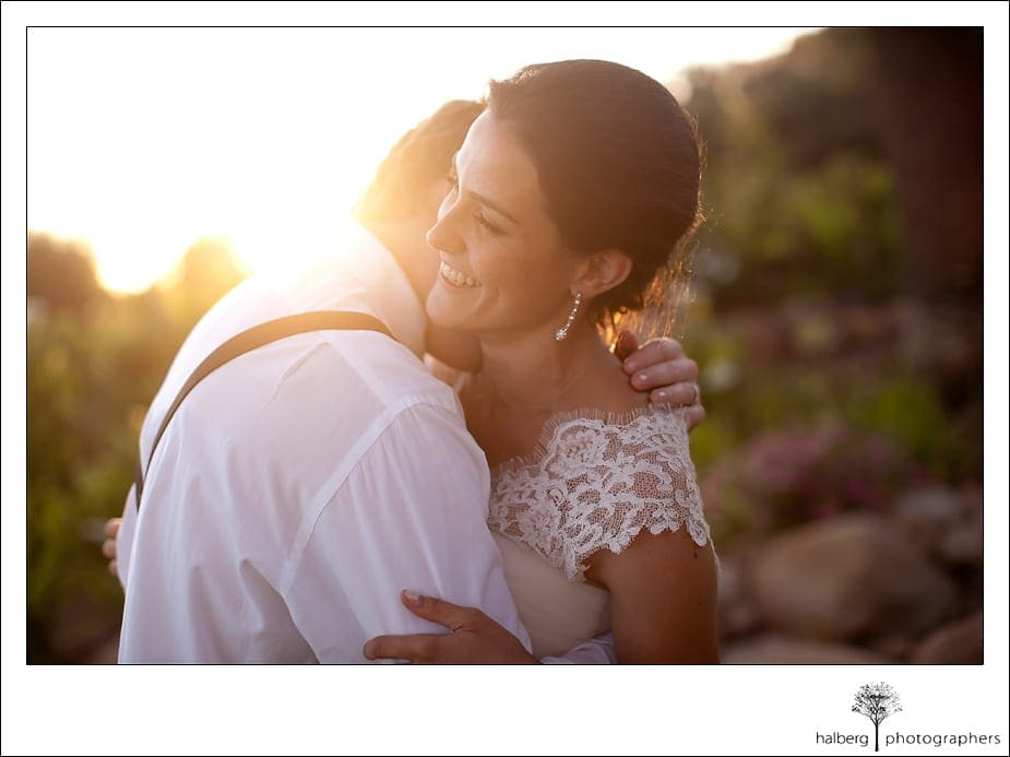 groom kisses brides neck at their Heartstone Ranch Wedding