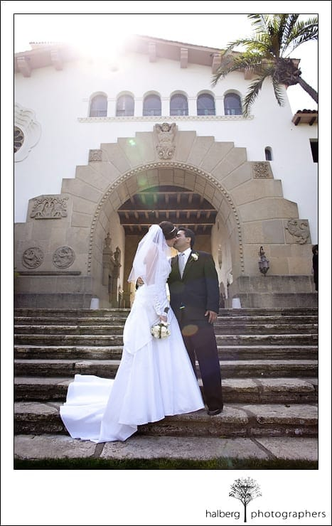 bride and groom kissing in sunken gardens after their santa barbara courthouse wedding