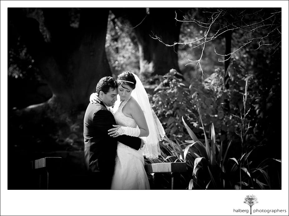 bride and groom embracing in park after their santa barbara courthouse wedding