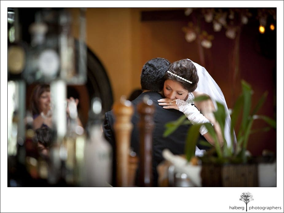 bride and groom embrace during first dance after their wedding at the santa barbara courthouse