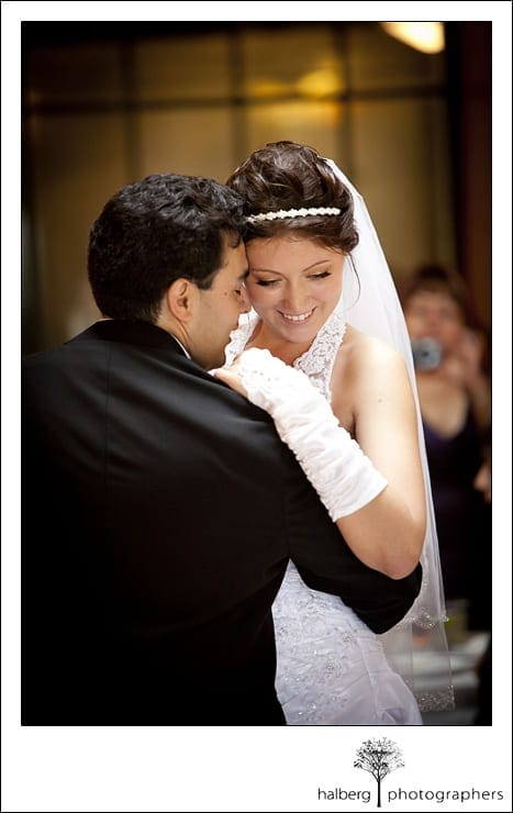 bride smiling and dancing with groom after santa barbara courthouse wedding