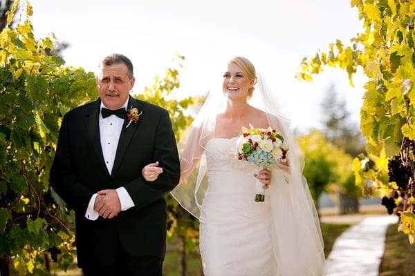 Kari's dad walking her down the aisle at Chateau Julien