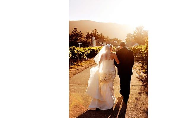 Tyler and Kari walk into the sunset at their wedding