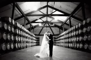 Tyler and Kari kiss after their wedding at Chateau Julien winery