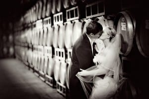 stolen moment in the Chateau Julien barrel room wedding