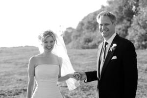 Jeff and Victoria all smiles at their wedding black and white