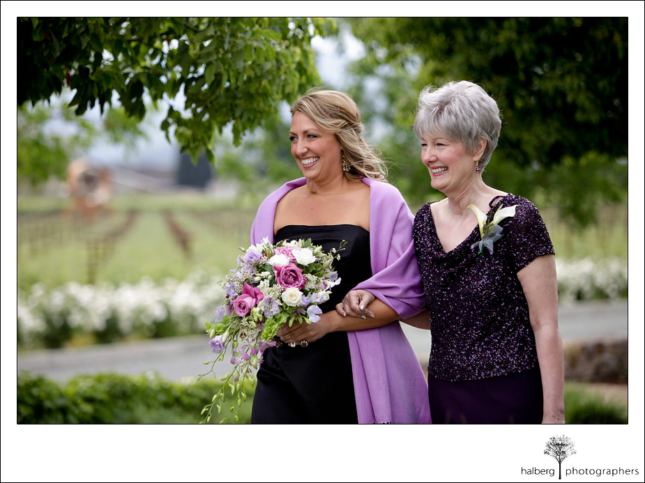 mom and bride's sister walk down isle at napa vineyard wedding