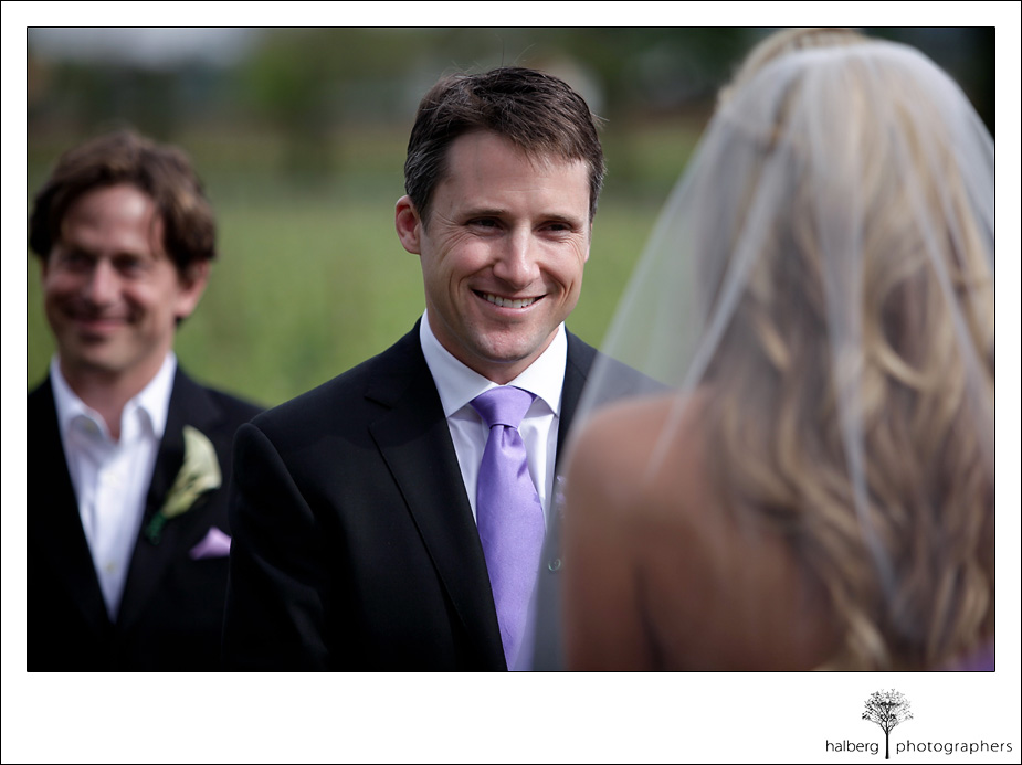 groom smiling at bride at their napa vineyard wedding