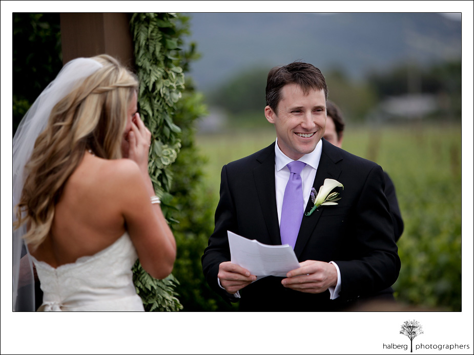 groom laughing while reading vows at his napa vineyard wedding