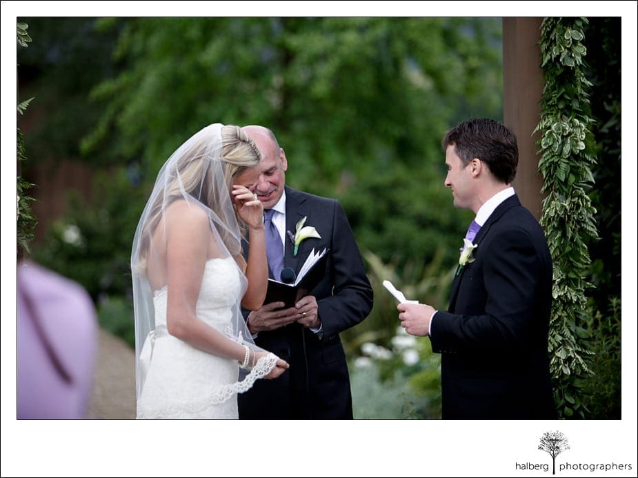 bride crying while reading vows at her napa vineyard wedding