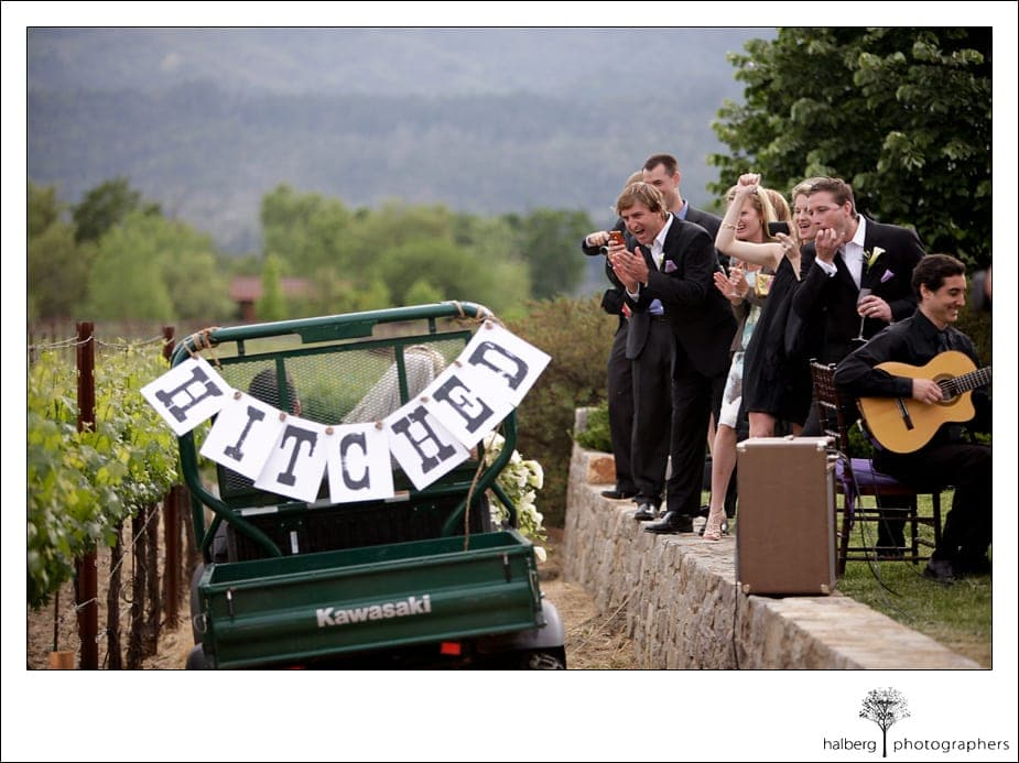bride and groom drive away hitched after their napa vineyard wedding ceremony